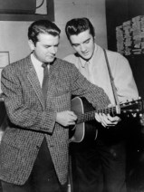"Music Producer and Florence native Sam Phillips, left, is seen with ""The King"" Elvis Presley at Sun Records in Memphis, Tennessee, during the 1950s. (From Encyclopedia of Alabama, courtesy of the Alabama Music Hall of Fame)"