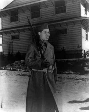 Joe Louis, former heavyweight champion, on guard duty at Camp Upton, N.Y., 1942. (Library of Congress Prints and Photographs Division)