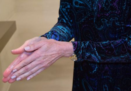 Rub hands vigorously to spread sanitizer completely over hands. (Donna Cope/Alabama NewsCenter)