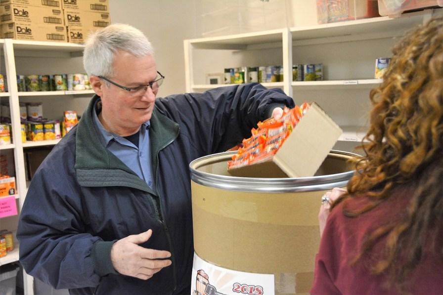 Forest Keith packs a Barrel of Love barrel. (Karim Shamsi-Basha / Alabama NewsCenter)