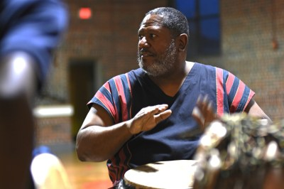 "Edmond ""Barry"" Johnbson leads housing authority youth in playing African drums. (Solomon Crenshaw Jr. / Alabama NewsCenter)"
