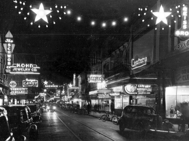 Dauphin Street between Conception Street and Joachim Street lit up for the holidays, c. 1940. (From Encyclopedia of Alabama, courtesy of the Doy Leale McCall Rare Book and Manuscript Library)