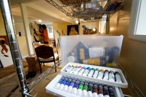 Maples enjoys mixing multiple types of painting in a single work, such as acrylic, watercolor and alcohol ink on one of her canvases. (Mark Sandlin/Alabama NewsCenter)