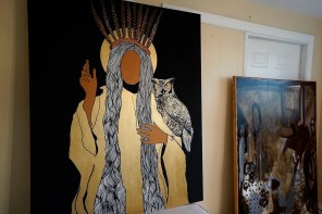 Maples began her popular Cherokee series after seeing an old photograph of a Cherokee woman wearing a white woman's dress, looking miserable. Her own figures appear without facial features, which she believes allows the observer to project something of himself or herself into the painting. (Mark Sandlin/Alabama NewsCenter)