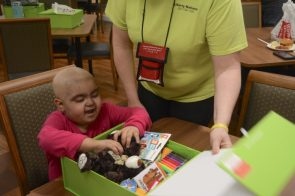 Contents of Cheeriodicals boxes bring automatic cheer. (Karim Shamshi-Basha/Alabama NewsCenter)