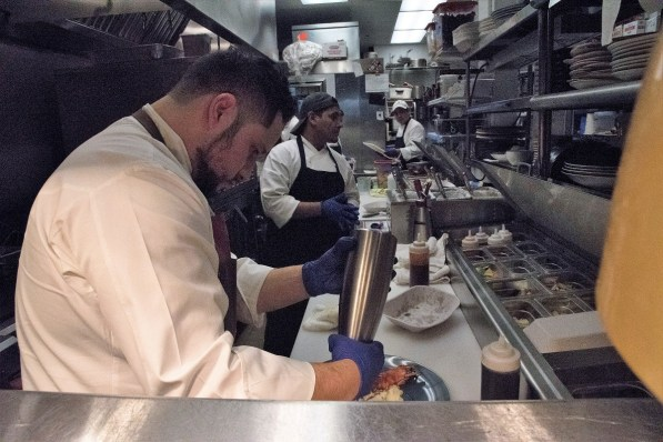 The kitchen at Purveyor Huntsville, led by executive chef Rene Boyzo, stays busy producing the creative dishes on an ever-evolving menu. (Brittany Faush/Alabama NewsCenter)