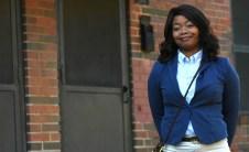 Samford junior Adriene Gadsden stands near the front door of her Loveman Village public housing residence. (Solomon Crenshaw Jr./Alabama NewsCenter)