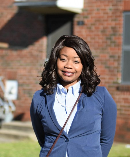 Samford junior Adriene Gadsden stands near the back door of her Loveman Village public housing residence. (Solomon Crenshaw Jr./Alabama NewsCenter)