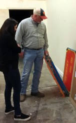 "Scott Morrow, Southern Custom Exhibits, shows Julia Meyer, Tatum Design, some of the production materials for the ""Making Alabama"" exhibition. AlabamaNewsCenter)"