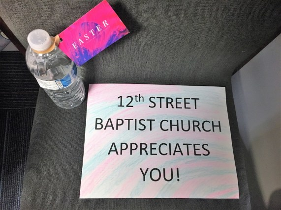 Children in Rainbow City handed out signs and bottles of water in support of Alabama Power crews working in east Alabama following the March 19 tornadoes and storms. (contributed)