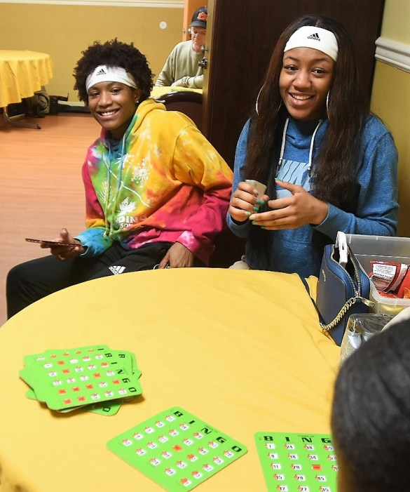 Ramsay basketball players Jayyn Sherrod and Brooke Kyle call the numbers in a game of bingo at South Rehabilitation and Health. (Solomon Crenshaw Jr. / Alabama NewsCenter)