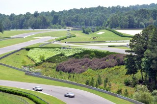Charlotte watches a race. (Barber Motorsports Park and Museum)