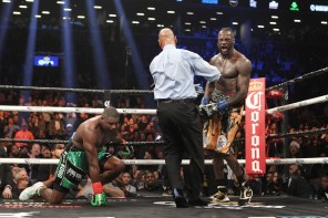 Deontay Wilder (gold shorts) successfully defended his WBC title by defeating Luis Ortiz with a TKO. (Tom Casino/Showtime)