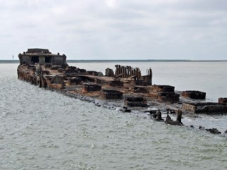 The wreck of the concrete ship SS Selma sit in Galveston Bay off the Texas coast. The experimental ship was built by F.F. Ley & Company in Mobile, Mobile County in 1919. It was intentionally sunk in 1922 after suffering irreparable damage to its hull. The ruins are often visible in the bay and are a popular attraction. (From Encyclopedia of Alabama, photo courtesy of Chuck Wilkson)