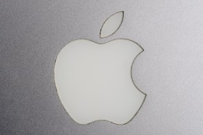 The Apple Inc. logo is seen on a MacBook Pro laptop computer. Apple is said to be developing its own chips for Mac computers to replace those manufactured by Intel. (Brent Lewin/Bloomberg)
