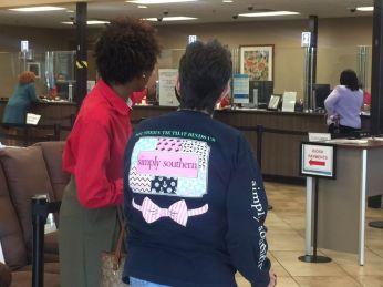 An Alabama Power employee helps a customer inside the Business Office. (Keisa Sharpe/Alabama NewsCenter)