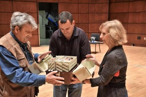 Amnon Weinstein with Marilyn Pipkin and his son, Avshi. Pipkin gave him a violin repair kit that belonged to her late husband. (Karim Shamsi-Basha/Alabama NewsCenter)