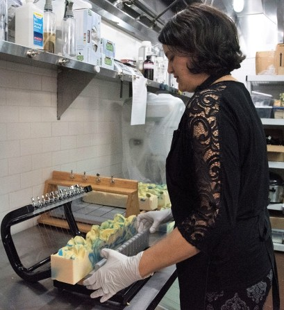 Deborah Bruijn cuts bars of soap at Fairhope Soap Co. (Brittany Faush / Alabama NewsCenter)