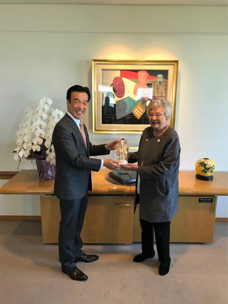 Yohshi Yamane, a senior managing director of Honda Motor Co., presents Gov. Kay Ivey with a model of Honda's Asimo robot as a memento of the Alabama group's trip to the automaker in Japan. (contributed)