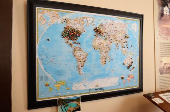 A map in the Monroe County Heritage Museum features pins showing where visitors traveled from. (Michael Tomberlin / Alabama NewsCenter)