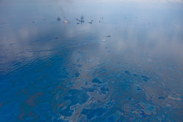 Burning and skimming operations in the Gulf of Mexico; June 10, 2010. (kris krüg, Wikipedia)