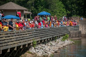 Students and volunteers crowd the pier at Oak Mountain State Park. (Billy Brown/Alabama NewsCenter)