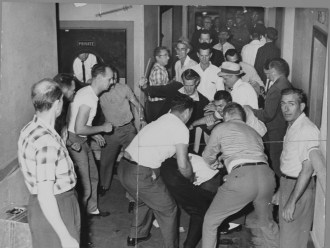 A mob beats Freedom Riders in Birmingham. This picture was reclaimed by the FBI from a local journalist who also was beaten and whose camera was smashed. (Wikipedia)