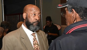Football great Tony Nathan is greeted by a former Negro League baseball player during his visit to the Negro Southern League Museum last year. Nathan will appear with former high school rival and Alabama Crimson Tide teammate Jeff Rutledge at a Thursday benefit for Banks Academy. (Solomon Crenshaw Jr./Alabama NewsCenter)