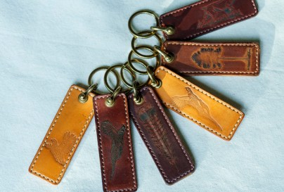 Andrew Lee's images of alabama flora and fauna stamped onto leather key chains. (Mark Sandlin/Alabama NewsCenter)