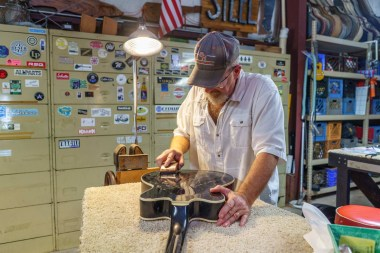 Roger Fritz both repairs guitars and builds them from scratch. His customers include everyday people as well as superstars such as The Rolling Stones. (Mark Sandlin/Alabama NewsCenter)