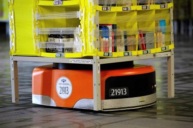 An automated transport robot moves goods in a storage unit at the Amazon.com Inc. fulfillment center in Robbinsville, New Jersey. (Bess Adler/Bloomberg)