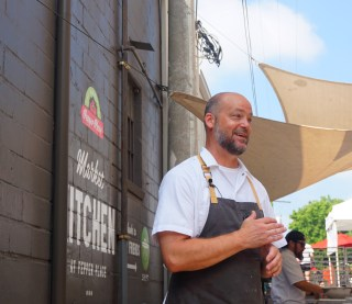 James Huckaby leading the chef's demo at the Market at Pepper Place June 2. (Erin Harney/Alabama NewsCenter)