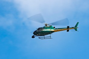 "A ""police"" helicopter flies above Birmingham Friday during filming of the movie ""Live!"" downtown. (Phil Free/Alabama NewsCenter)"