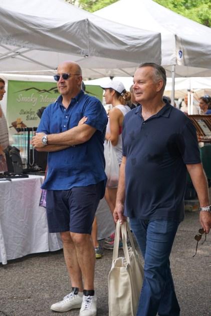 Andrew Zimmern and Frank Stitt enjoy a stroll through Pepper Place. (Erin Harney/Alabama NewsCenter)