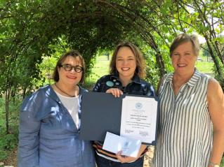 Becky Satterfield, left, and Rosemary Dallam, right, present Jones Valley Teaching Farm with the Les Dames d'Escoffier International Birmingham's Non-Profit Organization Award. (contributed)
