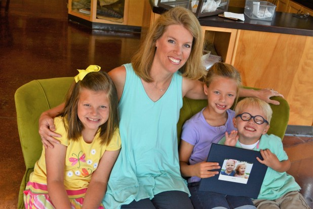 """Erin Miller with her children, Kate, Jenna and Elijah. The family's journey through Kate's struggle with leukemia is told in Erin's book, """"Fighting for Kate."""" (Karim Shamsi-Basha/Alabama NewsCenter)"""
