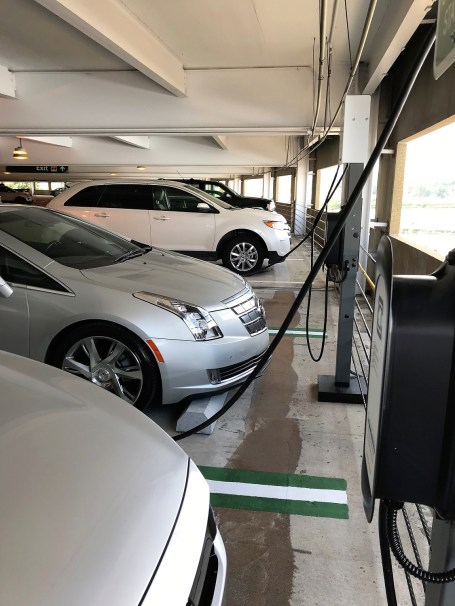 The first group of electric vehicles charge up at Birmingham-Shuttlesworth International Airport's new charging stations. (Michael Sznajderman/Alabama NewsCenter)