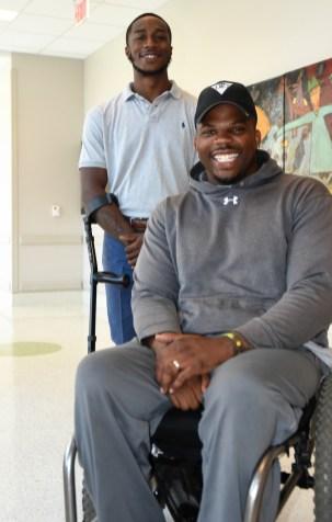 Montaeus Bell stands behind his mentor, Tim Alexander. (Solomon Crenshaw Jr./Alabama NewsCenter)