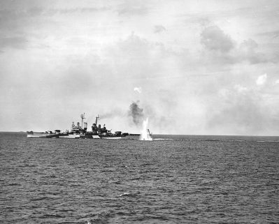 The USS Birmingham is near-missed by a Japanese coastal gun, while bombarding in support of the invasion of Saipan, June 1944. (U.S. Naval Historical Center National Archives)