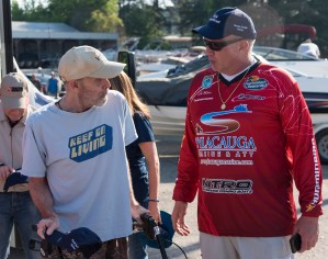 Vet Ed Kopp (left) and Lee Holmes have a word during a veterans fishing trip and day on Lake Logan Martin in Cropwell. (Bernard Troncale/Shorelines)