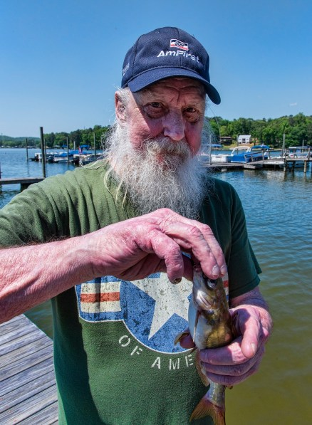 Army veteran Terry Yenour holds a catfish after a fishing trip on Lake Logan Martin. (Bernard Troncale/Shorelines)