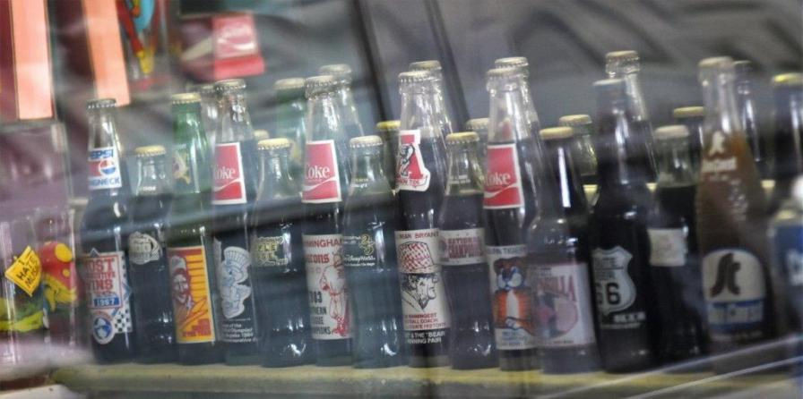 A drink bottle collection was among the interesting attractions at Vincent Oliver's Hippodrome Barber Shop in Woodlawn. (Solomon Crenshaw Jr. / Alabama NewsCenter)