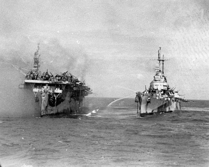 USS Birmingham (CL-62) assisting with firefighting of the burning USS Princeton (CVL-23), Oct. 24, 1944. (U.S. Navy Historical Center, National Archives, Wikipedia)