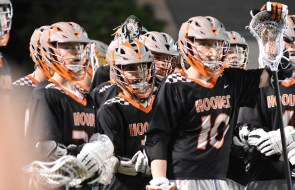Ziven Fowler, center, with his teammates during a Hoover Bucs lacrosse game. (Solomon Crenshaw Jr./Alabama NewsCenter)