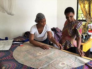 Stacey Scott, left, works with a Tanzanian woman in the Maasai Chic sewing room. (contributed)