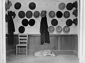 Steel and cotton mill workers hung their hats in the vestibule of a Gadsden Baptist church during a Sunday service in December 1940. (From Encyclopedia of Alabama, courtesy of the Library of Congress, photograph by John Vachon)