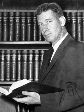 Frank M. Johnson graduated law school at the University of Alabama in 1943, where he befriended future Alabama Gov. George C. Wallace. Johnson was wounded in action as a soldier in Europe in World War II, and later defended enlisted men in court against charges of brutality, by exposing orders given them by senior officers. (From Encyclopedia of Alabama, courtesy of The Birmingham News.)
