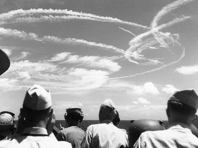 Contrails in the wake of fighter planes over the USS Birmingham, which saw action during the Battle of the Philippine Sea in 1944. (From Encyclopedia of Alabama, U.S. Naval Historical Center)