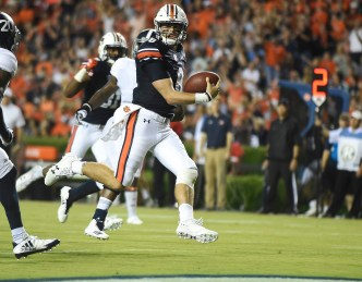 Auburn quarterback Jarrett Stidham runs for a touchdown against Georgia Southern last year. Stidham is on the preseason watch lists for some prestigious awards this season. (Todd Van Emst/AU Athletics)