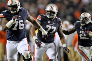 Auburn offensive lineman Prince Tega Wanogho (76) and Auburn offensive lineman Marquel Harrell (77) block down field during a touchdown run by Kerryon Johnson in last year's dominating regular-season win over Georgia. (Todd Van Emst/AU Athletics)